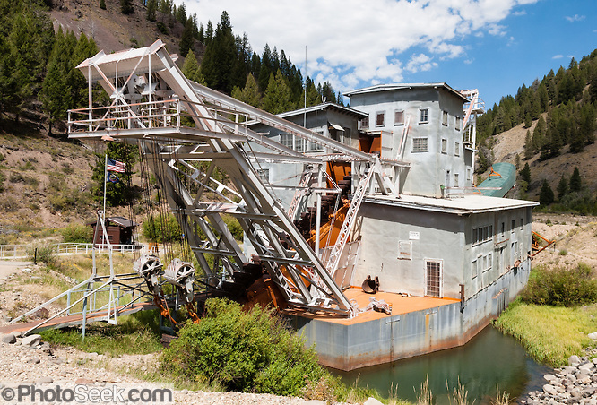 Yankee Fork Gold Dredge operated from 1940-1952 near near Custer Historic Site, in Idaho, USA. This floating gold dredge chewed a wide swath of stream gravel leaving rocky dredge tailings along 5.5 miles of the Yankee Fork, a tributary of the Salmon River, near Stanley, Idaho, USA. It recovered an estimated $1,037,322 in gold and silver at a cost of $1,076,100. Visit Land of the Yankee Fork State Park in Salmon-Challis National Forest near Stanley, Idaho.